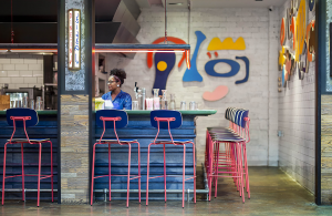 Reece Barstools in Custom Pink With Navy Seats at Recess